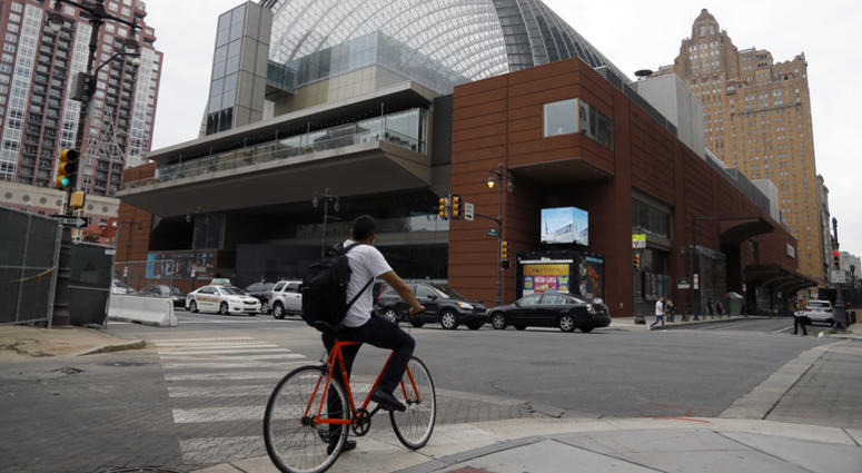 A cyclist passes by The Kimmel Center for the Performance Arts, Tuesday, Aug. 13, 2019, in Philadelphia. On Tuesday, the Philadelphia Orchestra rescinded an invitation for Placido Domingo appear at its opening night concert in September.