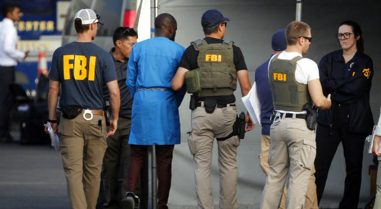 U.S. authorities have unsealed a 252-count federal grand jury indictment charging 80 people with participating in a conspiracy to steal millions of dollars through a range of fraud schemes and laundering the funds through a Los Angeles-based network.