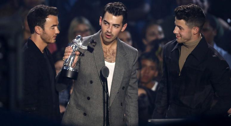"""Kevin Jonas, from left, Joe Jonas and Nick Jonas, of the Jonas Brothers accept the best pop award for """"Sucker"""" at the MTV Video Music Awards at the Prudential Center on Monday, Aug. 26, 2019, in Newark, N.J."""