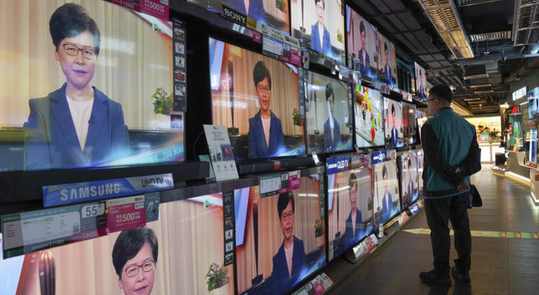 A man watches the television message that Hong Kong Chief Executive Carrie Lam makes an announcement on the extradition bill, at a home electronics retailer in Hong Kong, on Wednesday, Sept. 4, 2019.