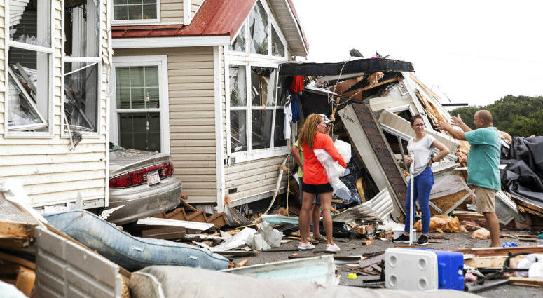 Residents of the Boardwalk RV Park discuss the path of a possible waterspout or tornado, generated by Hurricane Dorian, struck the area.