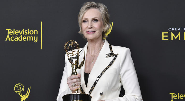"""Jane Lynch poses in the press room with the award for outstanding guest actress in a comedy series for """"The Marvelous Mrs. Maisel"""" on night two of the Creative Arts Emmy Awards on Sunday, Sept. 15, 2019, at the Microsoft Theater in Los Angeles."""