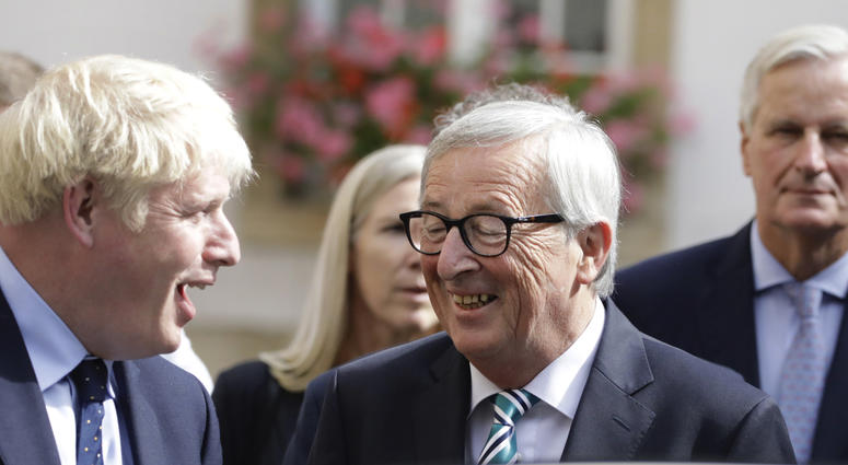 European Commission President Jean-Claude Juncker, center, speaks with British Prime Minister Boris Johnson, left, after a meeting in Luxembourg, Monday, Sept. 16, 2019.