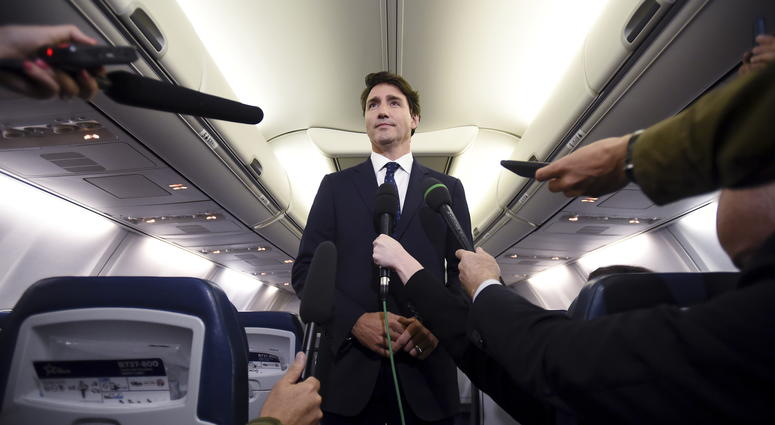 """Canadian Prime Minister and Liberal Party leader Justin Trudeau makes a statement in regards to a photo coming to light of himself from 2001, wearing """"brownface,"""" during a scrum on his campaign plane in Halifax, Nova Scotia, Wednesday, Sept. 18, 2019."""