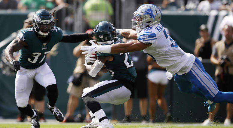 Detroit Lions' Miles Killebrew, right, tackles Philadelphia Eagles' Miles Sanders during the first half of an NFL football game, Sunday, Sept. 22, 2019, in Philadelphia.