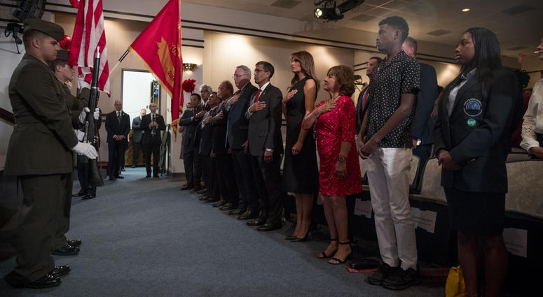 First lady Melania Trump, center, and acting DEA Administrator Uttam Dhillon, center left, stands at a Red Ribbon Rally at the Drug Enforcement Agency in Arlington, Va., Monday, Oct. 7, 2019.