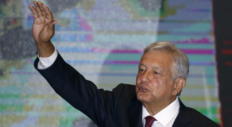 Presidential candidate Andres Manuel Lopez Obrador waves to supporters as he gives his first victory speech at his campaign headquarters in Mexico City, Sunday, July 1, 2018.