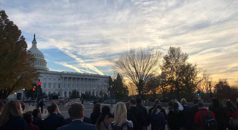 Crowds at foot of Capitol await the arrival of the 41st President.