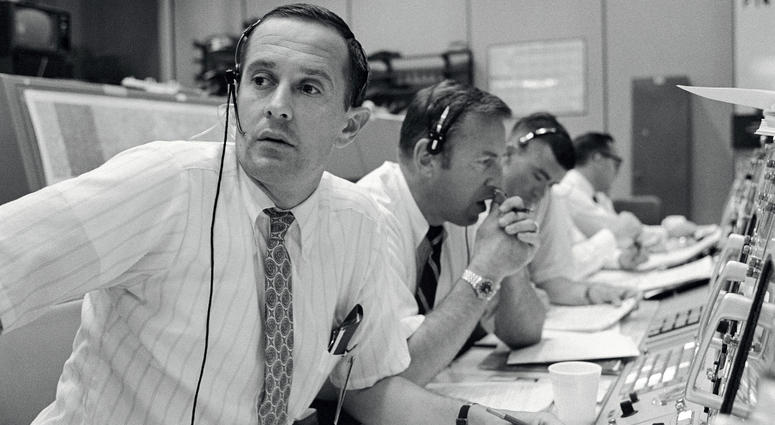 CAPCOM Charles Duke, with backup crewmen Jim Lovell and Fred Haise listening in during Apollo 11's descent