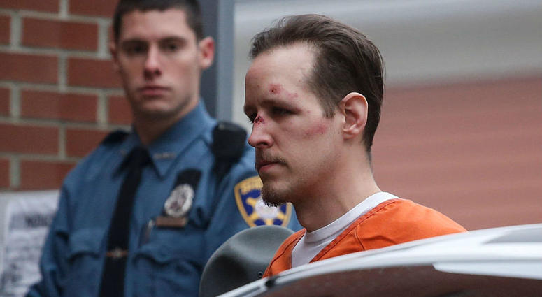 Eric Frein arrives for arraignment to court on October 31, 2014 in Milford, Pennsylvania. Frein, a suspected cop killer, was taken into custody from a Pennsylvania airport hangar after a seven-week manhunt.