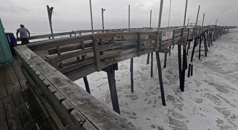 Waves crash under the Avalon Fishing Pier in Kill Devil Hills, N.C., Thursday, Sept. 13, 2018 as Hurricane Florence approaches the east coast.