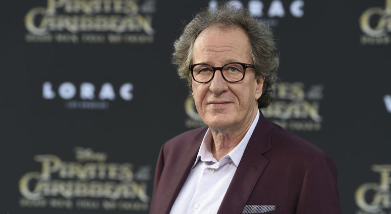 "In this May 18, 2017, file photo, Geoffrey Rush arrives at the Los Angeles premiere of ""Pirates of the Caribbean: Dead Men Tell No Tales"" at the Dolby Theatre."