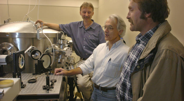 """In this Monday, June 28, 2004 file photo, University of Michigan Professor Gerard Mourou, center, and fellow research scientists talk about the potential of the laser, dubbed """"Hercules,"""" that has been built at the University of Michigan lab."""