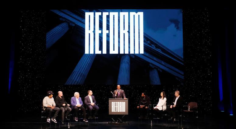 "Shawn ""Jay-Z"" Carter, Michael Novogratz, Robert Kraft, Michael Rubin, Van Jones, Meek Mill, Clara Wu Tsai, Dan Loeb speak onstage during the launch of The Reform Alliance at John Jay College on Jan. 23, 2019 in New York City."