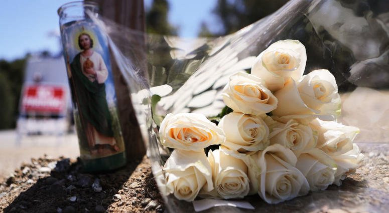 GILROY, CALIFORNIA - JULY 29: Flowers and a candle sit outside the site of the Gilroy Garlic Festival after a mass shooting there yesterday on July 29, 2019 in Gilroy, California. Three victims were killed and at least a dozen were wounded before police o