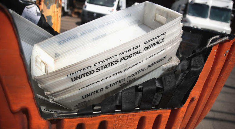United States Postal Service boxes are stacked up.