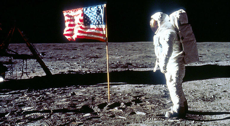 """Astronaut Edwin """"Buzz"""" Aldrin poses next to the U.S. flag July 20, 1969 on the moon during the Apollo 11 mission."""