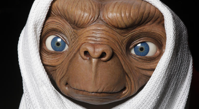 Studio artist rides E.T. figure to its new home in the film experience at Madame Tussauds New York for the anniversary of Universal Studios/Amblin Entertainment's E.T. the Extra-Terrestrial on June 10, 2014 in New York City.