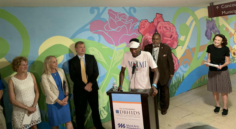 Officials unveiled a new mural in Septa's suburban station Tuesday, but the artwork was only part of the story. The mural is the product of a program to reduce panhandling by providing low barrier jobs that offer same-day pay.