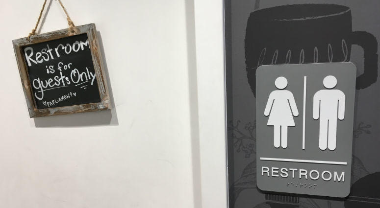 The sign on the restroom door in Parliament Coffee says it is for guests only.
