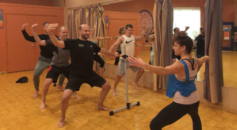 Instead of hitting the weight room, these men are hitting the barre.