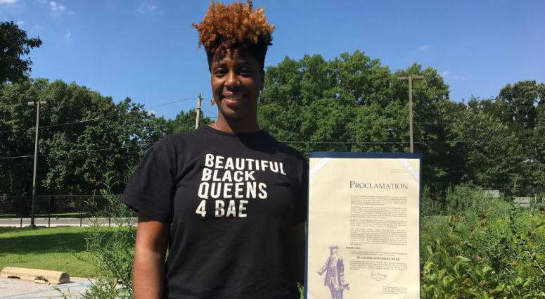 BBQ4BAE co-host Jabina Coleman holds a city proclamation for recognition of her group's work during Black Breastfeeding Week.
