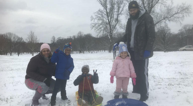 The Fassett family is ready for some fun in the snow at the Belmont Plateau.