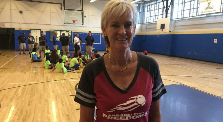 World–renowned tennis coach gives some pointers to kids at Police Athletic League Center.