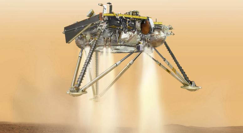 This illustration made available by NASA in October 2016 shows an illustration of NASA's InSight lander about to land on the surface of Mars.