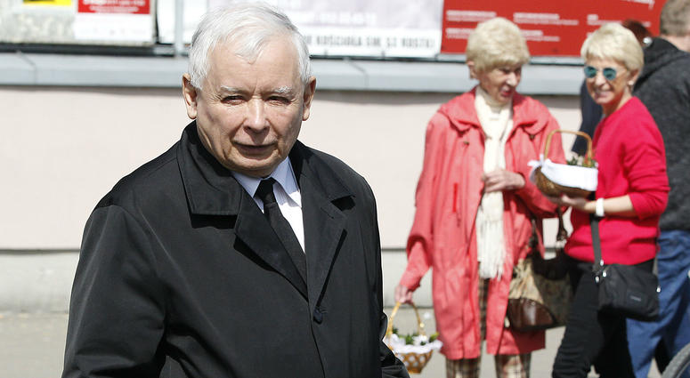 Jaroslaw Kaczynski, the leader of Poland's conservative ruling party, takes part in a Polish tradition of taking a basket to church for a blessing in Warsaw, Poland, Saturday, April 20, 2019.