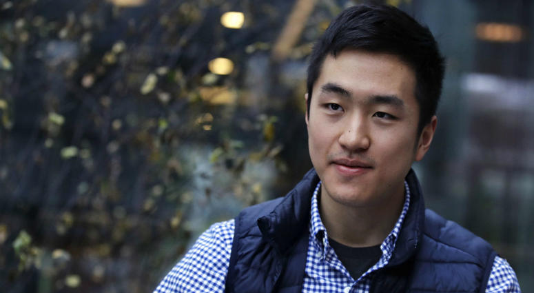 Harvard University graduate Jin K. Park, who holds a degree in molecular and cellular biology, listens during an interview in Cambridge, Mass., Thursday, Dec. 13, 2018.