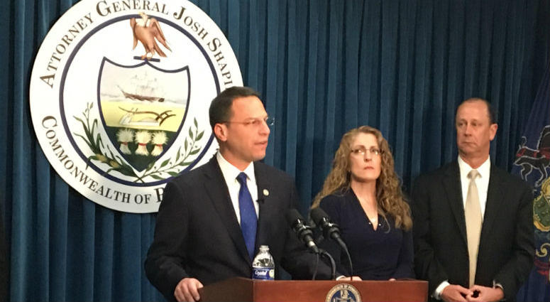 Attorney General Josh Shapiro stands with Timothy Piazza's parents