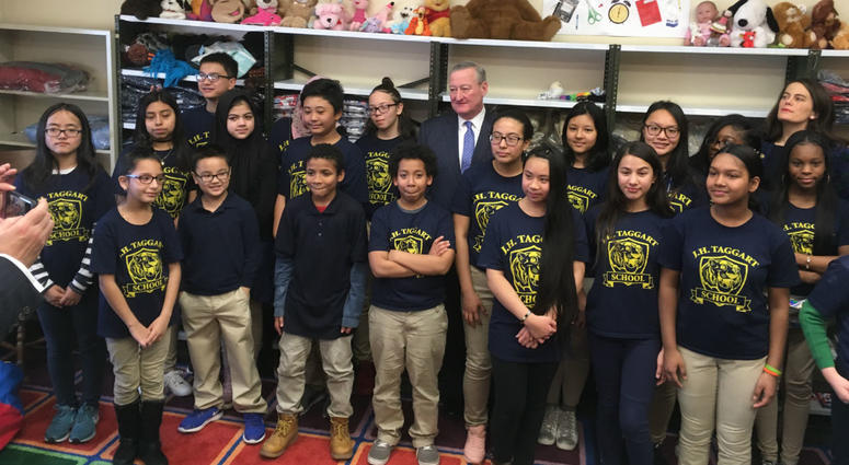 Philadelphia Mayor Jim Kenney and Pa. Rep. Elizabeth Fiedler stand with students from, Taggart elementary School in South Philly.
