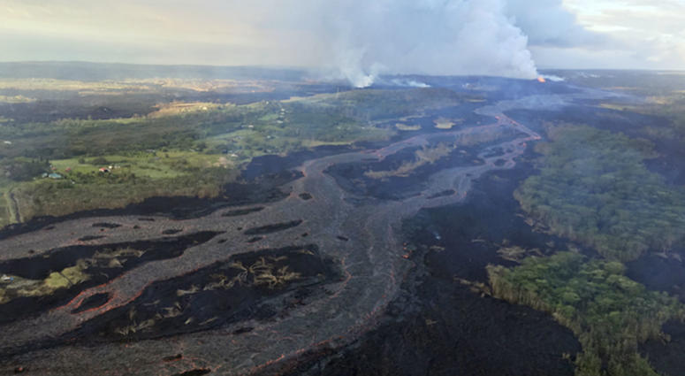 Kilauea's lower East Rift Zone, showing continued fountaining of a fissure and the lava flow channel fed by it