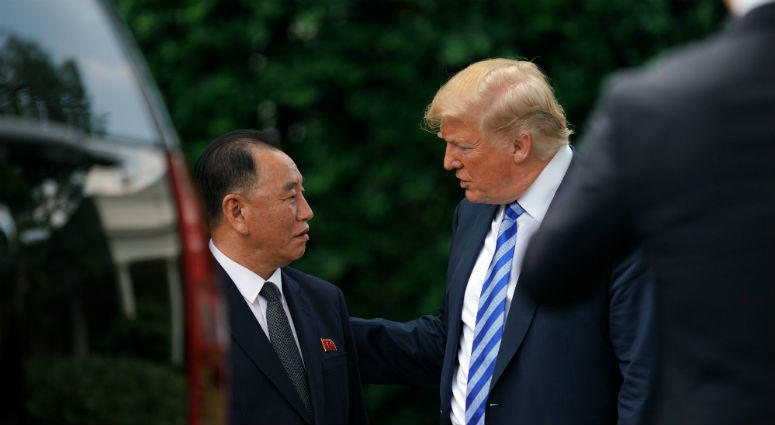 President Donald Trump talks with Kim Yong Chol