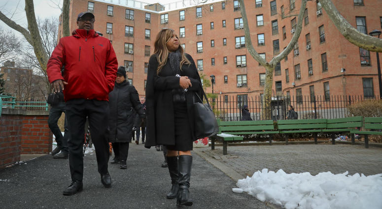 In this March 6, 2019 photo, Lynne Patton, right, HUD executive, and Robert Madison, left, associate director of community organization Jacob Riis Settlement, tour Queensbridge Houses residencies in New York