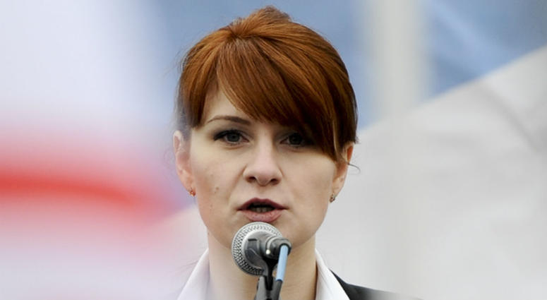 In this photo taken on Sunday, April 21, 2013, Maria Butina, leader of a pro-gun organization in Russia, speaks to a crowd during a rally in support of legalizing the possession of handguns in Moscow, Russia.