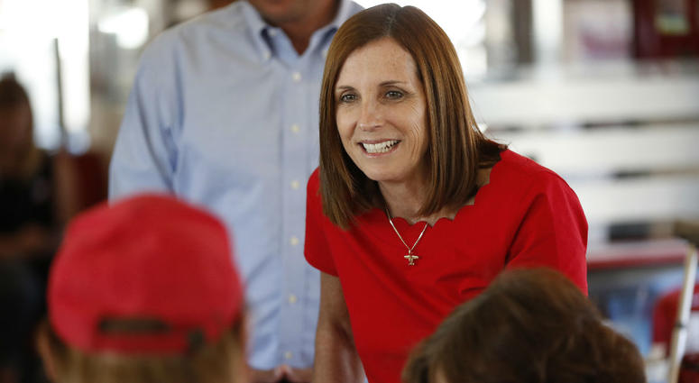 In this Nov. 6, 2018, file photo, Arizona Republican senatorial candidate Martha McSally, speaks with voters, at Chase's diner in Chandler, Ariz.