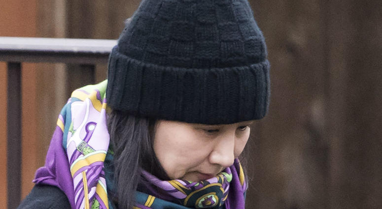 In this Wednesday, Dec. 12, 2018 file photo, Huawei chief financial officer Meng Wanzhou leaves her home in Vancouver, British Columbia.