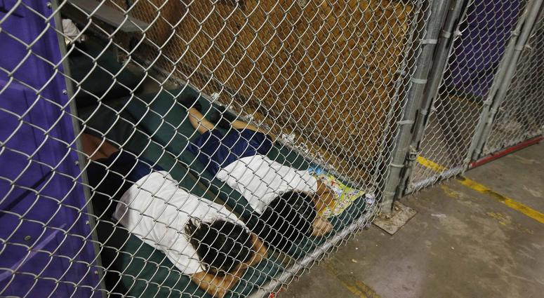 Two female detainees sleep in a holding cell at a US Customs and Border Protection center in Nogales, Arizona, on June 18, 2014.