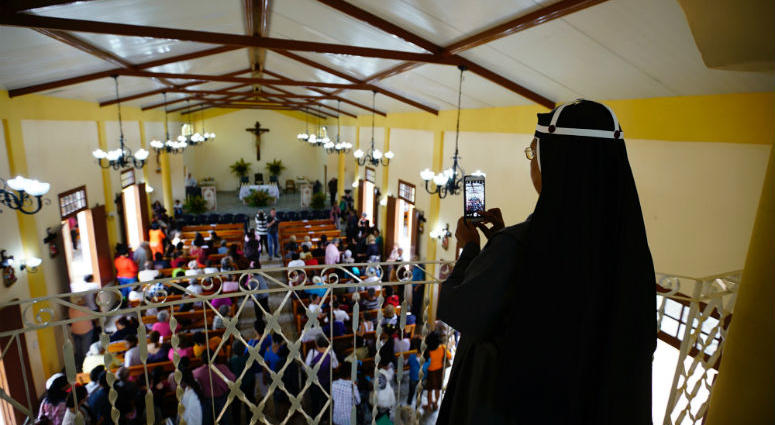 A Roman Catholic nun takes a photo with her phone at the Sacred Heart Church of Jesus in Sandino, Cuba. The church is the first new Catholic church to be built on the communist-run island since 1959.