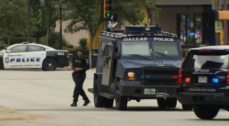 """Dallas Police said that a suspect in an """"active shooter incident"""" was shot during an exchange of gunfire with federal officers in downtown Dallas."""