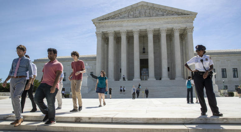 Visitors depart the Supreme Court early Monday, June 25, 2018. The justices are expected to hand down decisions this week as the court's term comes to a close.