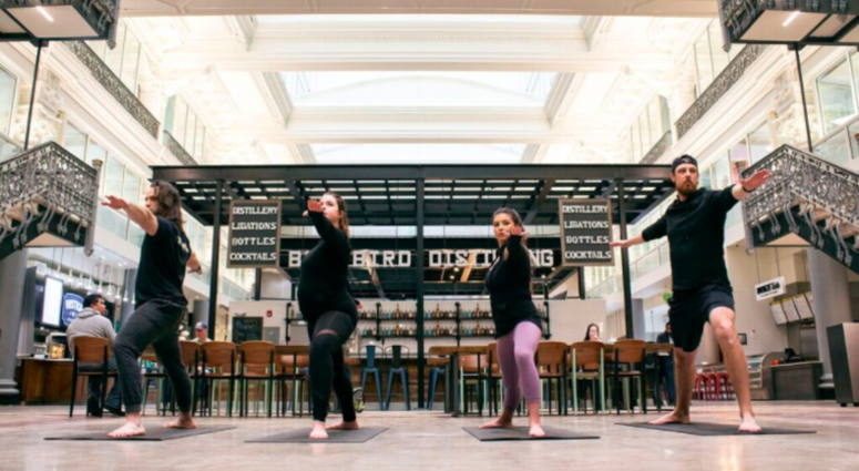 The month-long pop-up event offers free yoga classes from 9 to 10 a.m. every Saturday in February under the atrium in The Bourse's main dining hall.