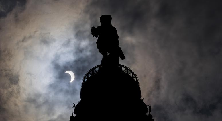 Aug 21, 2017; Philadelphia, PA, USA; A general view of the William Penn statue atop City Hall during the 2017 partial solar eclipse in Philadelphia, PA.