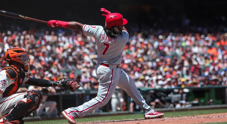 Philadelphia Phillies third baseman Maikel Franco (7) hits a single during the fourth inning against the San Francisco Giants at AT&T Park.