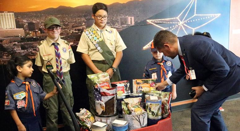 Mario Perez, right, Scout Executive and CEO for the Boy Scouts of America Yucca Council, checks the placement of popcorn on a wagon with scouts Monday at El Paso City Hall on Aug. 6, 2018.