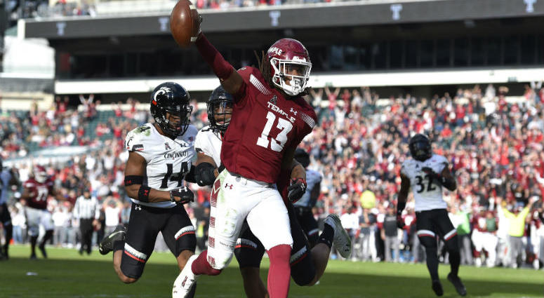 Temple Owls wide receiver Isaiah Wright (13) celebrates in the end zone after scoring a touchdown past Cincinnati Bearcats cornerback Cameron Jefferies (14) and safety Darrick Forrest (5) during overtime.
