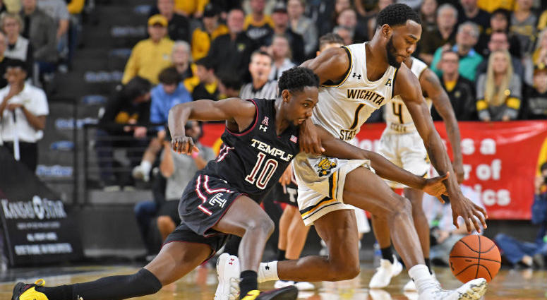 Jan 6, 2019; Wichita, KS, USA; Temple Owls guard Shizz Alston Jr. (10) reaches in for the ball against Wichita State Shockers forward Markis McDuffie (1) during the second half at Charles Koch Arena.