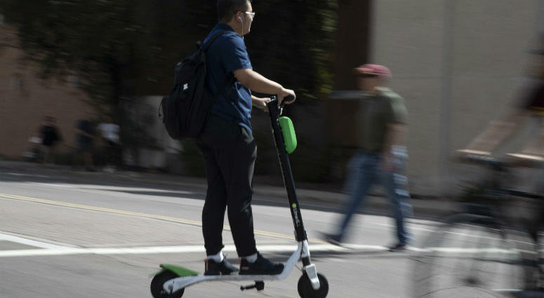 A man rides a scooter Oct. 4, 2018, in Tempe.
